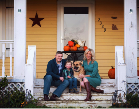 logan and family sitting on the porch with their dog