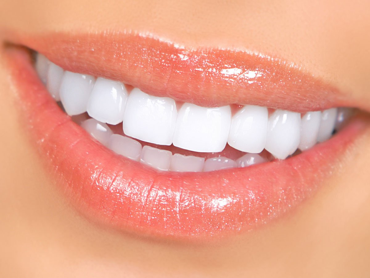 woman smiling with lip gloss